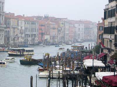 "The larger light yellow boat on the center left side of the picture is public transportation--a ""vaporetto.""  Most of the locals use these, as water taxis are quite expensive.  And gondolas are slow and basically for tourists."