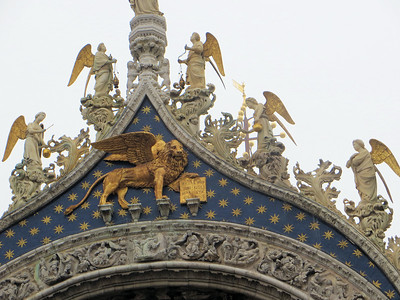 The winged lion with its foot on the gospel is a symbol of St. Mark, and, by extension, of Venice itself.  You see this motif all around the city.