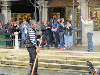 There used to be thousands of gondolas in Venice; now there are only 400, used almost exclusively by tourists.  Gondolieri are licensed by a guild and rates are fixed.  The uniform of black pants and striped shirt is required.  I think there is also a hat but I never saw anyone wearing one.  Some gondolieri will talk during your ride but this depends on the person.  Do they sing, as legend has it?  Most don't but some do--we heard one.  And he was very good, too!