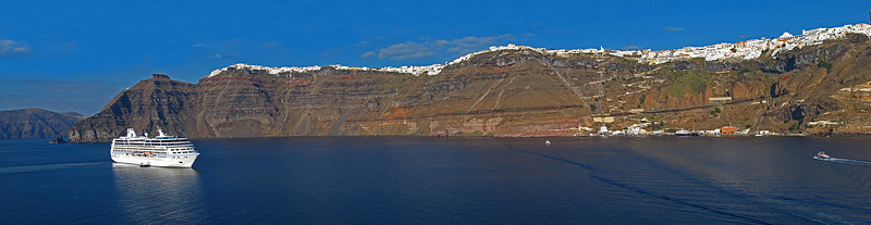 Early morning at the Greek Island of Santorini.  The visiting cruise ship helped complete the scene.  A panorama of four stitched images.