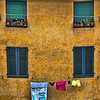 Four windows and laundry, Lucca, Italy