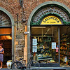Red-headed woman and Salumeria, Lucca, Italy