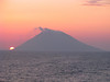 Mount Stromboli erupting at sunset