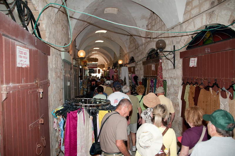 Walking through shopping area of Old City of Acre