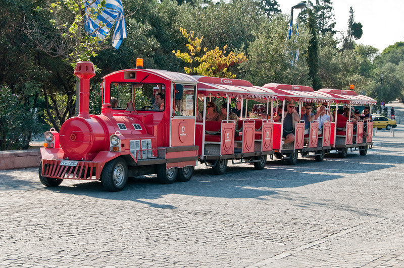 Small train transportation that goes around the base of the  Acropolis