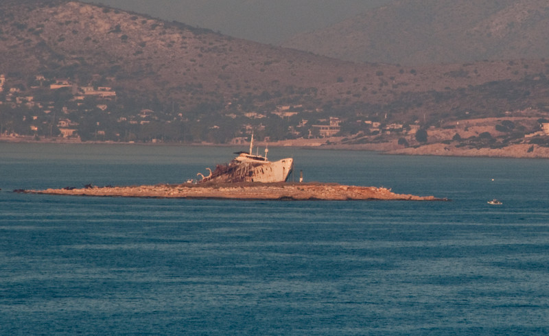 A ship that ran aground on a little island just outside the Piraeus Port
