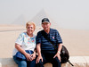 Sandy and Arnold sitting in front of the Pyramids