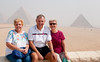 Sandy, Tom, and Judy setting in front of the Pyramids