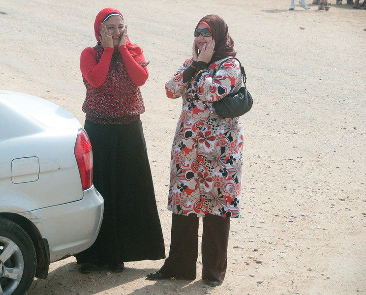 Two local ladies in the Pyramids of Giza parking lot and they can't believe what they are seeing