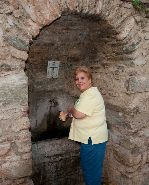 Sandy filling up her container with Holy Water that all leaked out before we got it back home.