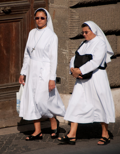 A couple Nuns walking by