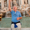 Max Levin throwing coins into Trevi Fountain