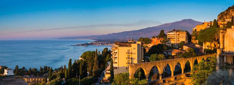 Sunrise hitting the top of Mount Etna Volcano, Taormina, East Coast of Sicily, Ionian Sea, Mediterranean Sea, Italy, Europe