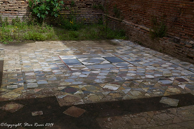 "Tiled floor  inside the ""decorated houses"" of Ostia Antica"