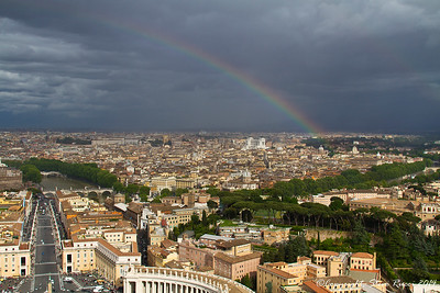 Looking out at Rome, with a rainbow, from the top of the dome of St. Peter's basilica.