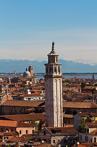 The Venetian skyline, with the bell tower of the Santa Maria dei Carmini church in foreground.