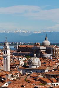 Looking across the Venetian skyline, with the San Giorgio dei Greci church in foreground and the Basilica dei Santi Giovanni e Paolo in background.