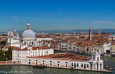 Venetian skyline, with the Santa Maria della Salute church and Punta Della Dogana museum in foreground.