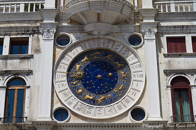 Close up of the clock face on the clock tower in St. Mark's square, Venice, Italy.