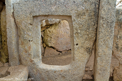 A square hole cut out of one of the huge stones at Hagar Qim.