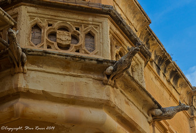Gargoyle dogs on one of the buildings in Mdina, Malta.  The center one must be bird dog.