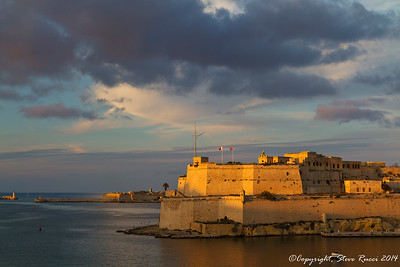 Fort Saint Angelo in Valletta harbor at sunset.