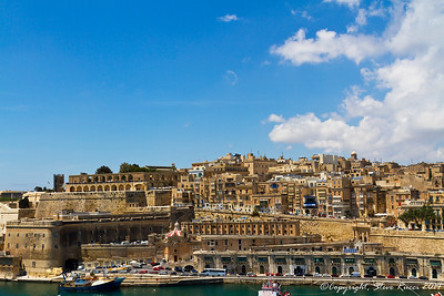 The Upper Barrakka Gardens and fortifications along Valletta harbor.