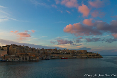 Valletta harbor at sunset.