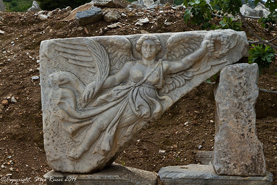 Stone carving of Nike at the ancient ruins at Ephesus, Turkey