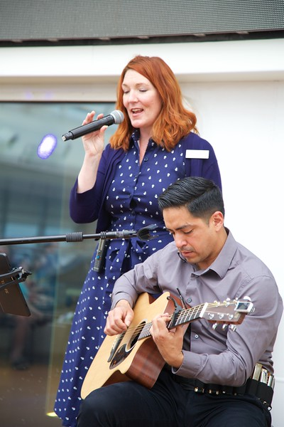 On Viking Star: Pool Deck: Jenna singing with guitarist Daniel