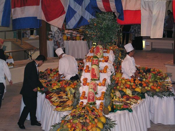 The fruit buffet features many carved fruits as well as a variety of exotic fruits to sample.