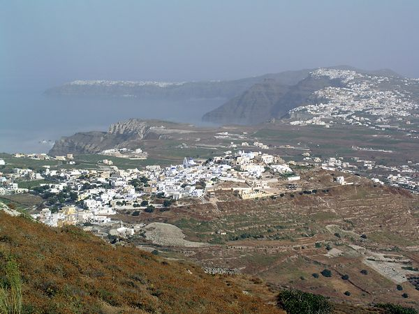 A view of the sea as we head up to the village of Pyrgos. The fog is beginning to lift and we can see the curve of land that circles the caldera.