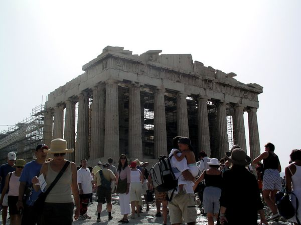 The Parthenon, dedicated to the goddess Athena, the patroness of Athens. It is built in the Doric style. Today is a Sunday, hot and humid and the place is swarming with tourists.