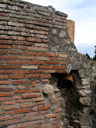 The first inhabitants of Pompeii built with stones. Later the Romans renovated and restored using bricks.