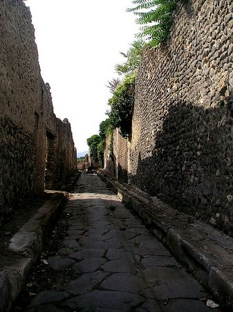 The narrow streets are paved with stone.