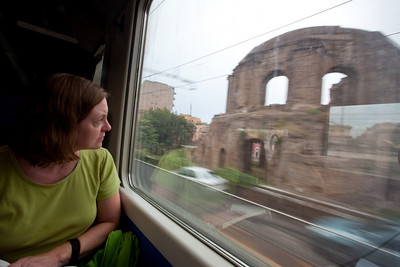 Linda looking at the scenery.  There are ruins everywhere.  Also the Italians have some very creative graffiti artists.