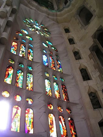 Looking up at the stained glass windows. The window on the lower left is missing.