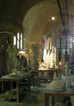 Inside, we find Gaudi's workshop, where craftsmen are still at work executing the detailed designs left by Gaudi after his death.