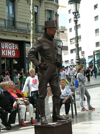 Along Las Ramblas there are news stands, flower stands, mimes, made up to resemble statues. They stand for hours changing position from time to time.