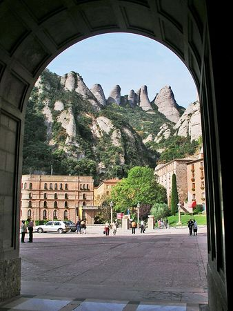 "A view of the ""serrated mountain"" through an arch as we come out of the courtyard of the basilica."