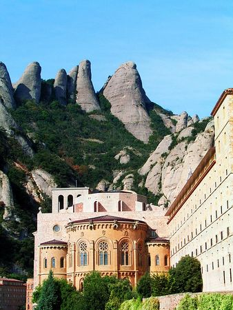 "The basilica at Montserrat. Behind the altar is the shrine of the ""Black Madona."""