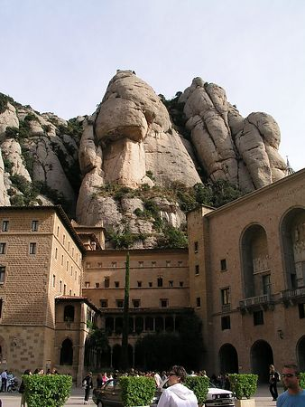 TThe buildings are built right against the mountain. The huge peaks tower above, but the stone buildings blend right in.