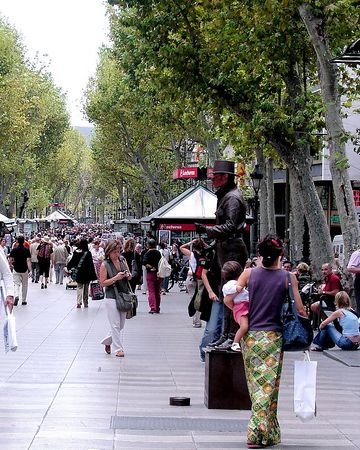 Thousands of people crowd the famous boulevard known as Las Ramblas in Barcelona.
