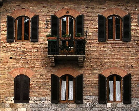 Windows - San Gimignano, Italy - I like the line up of windows and the fact that one is closed. It ads a bit of mystery.