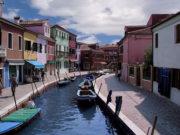A Burano canal lined with colorful buildings