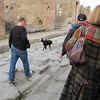 Another street scene, with some of our group walking along with a free dog.