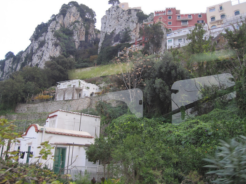 "Riding the ""Funicular"" to the top of the Isle of Capri.  These are the houses built on the side of the mountain along the way."