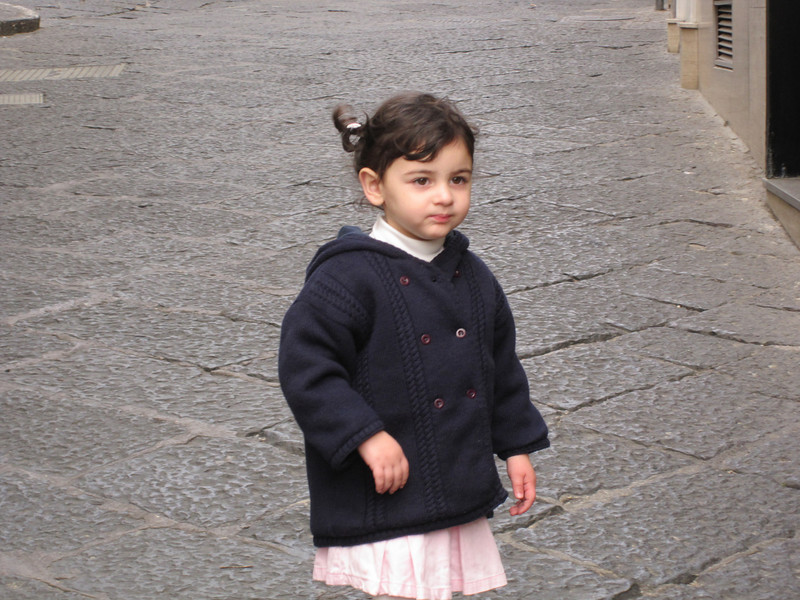 A darling little Italian girl.  She wanted more pictures taken, but soon lost interest.