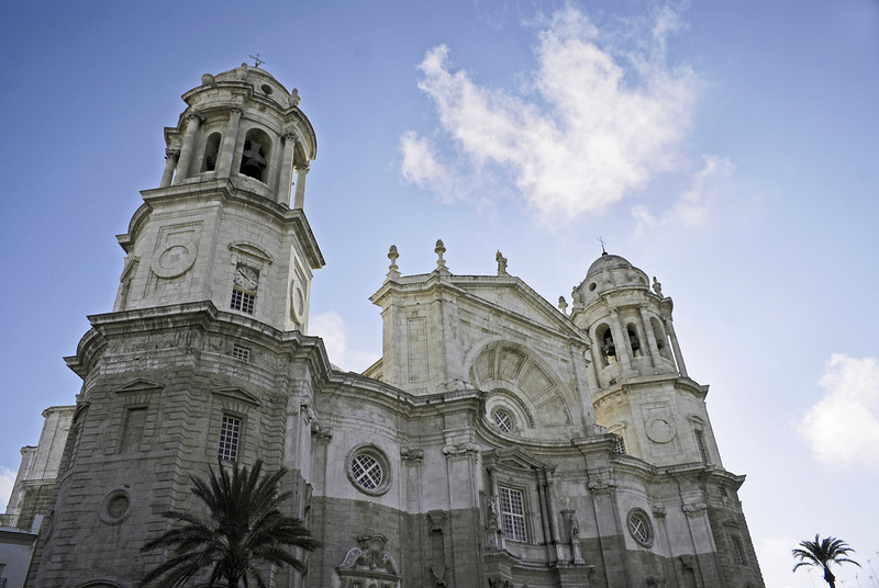 """Frontal view of Cadiz Cathedral, also known as Catedral Nueva (""""New Cathedral""""), Spain with blue sky."""