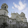 "Frontal view of Cadiz Cathedral, also known as Catedral Nueva (""New Cathedral""), Spain with blue sky."